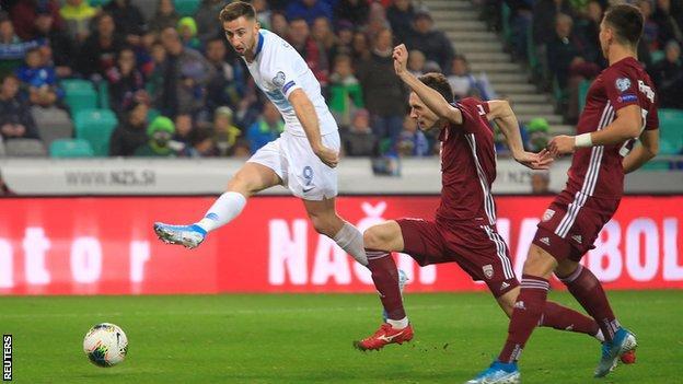 Andraz Sporar (left) in action for Slovenia