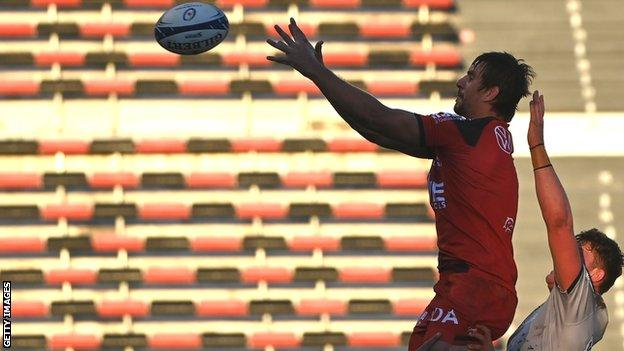 Toulon's South African lock Eben Etzebeth jumps for the ball during the European Rugby Champions Cup match against Sale Sharks at Mayol Stadium in Toulon