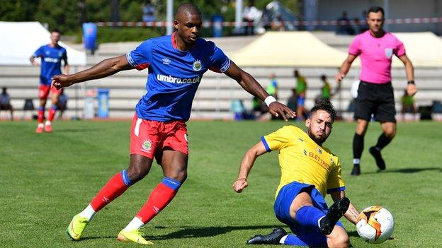 Linfield's Christy Manzinga closes in on Allessandro D'ddario of Tre Fiori