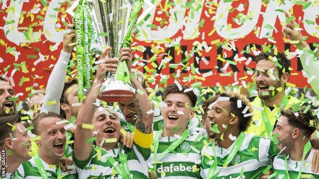 Celtic captain Scott Brown lifts the Scottish Premiership trophy