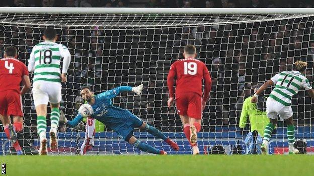 Joe Lewis of Aberdeen saves Scott Sinclair's penalty for Celtic