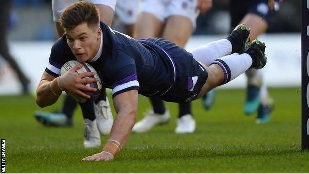 Huw Jones dives over to score the first of his two tries