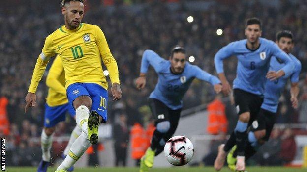 Neymar scores a penalty for Brazil