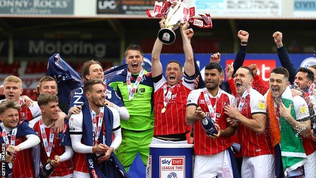 Cheltenham celebrate with the League Two trophy