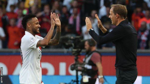 Neymar and Thomas Tuchel embrace