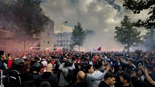 Fans gather outside of the home of Dutch midfielder Abdelhak Nouri on July 14, 2017 in Amsterdam. Ajax Amsterdam's football player Abdelhak Nouri was diagnosed with 'serious and permanent brain damage' after collapsing on July 8 during a practice match against Werder Bremen