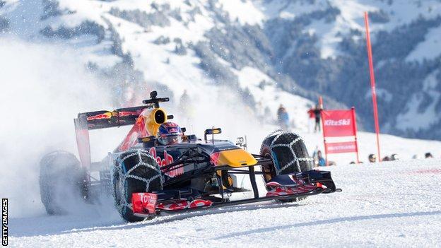Max Verstappen drives a Red Bull F1 car on the ski slopes of Kitzbuhel
