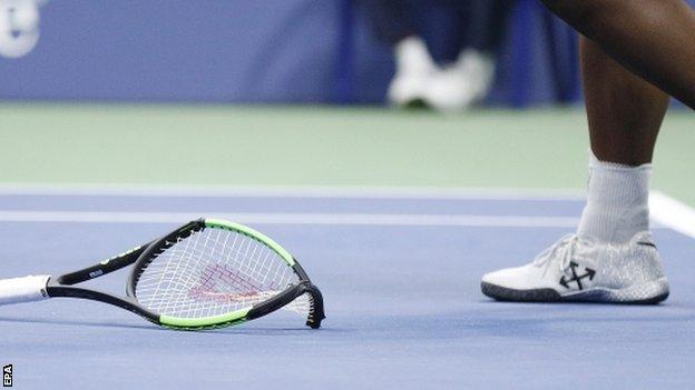 Serena Williams' smashed racquet on the court at Arthur Ashe Stadium