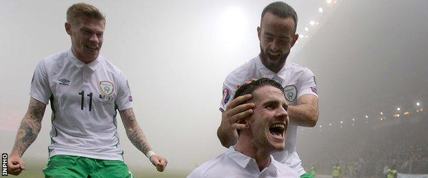 Robbie Brady is congratulated by Republic team-mate Marc Wilson after scoring his goal