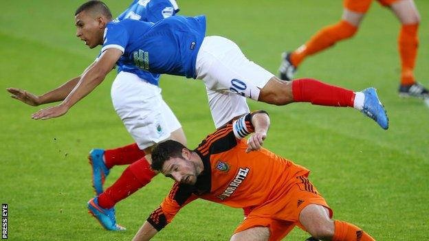 Linfield's TJ Murray is challenged by William Beckett of Glebe Rangers