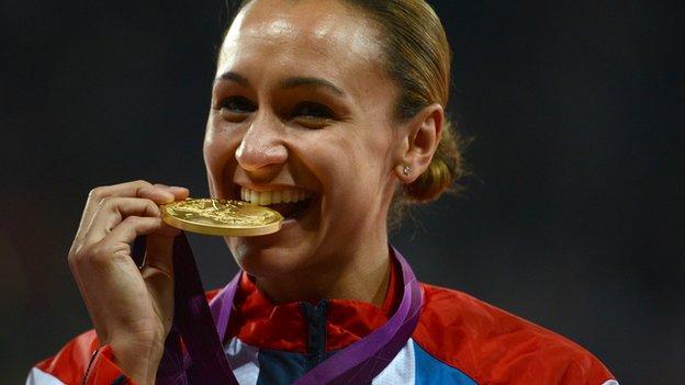 Jessica Ennis-Hill bites her Olympic gold medal