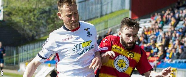 Caley Thistle's Gary Warren tackles Partick Thistle's Stevie Lawless