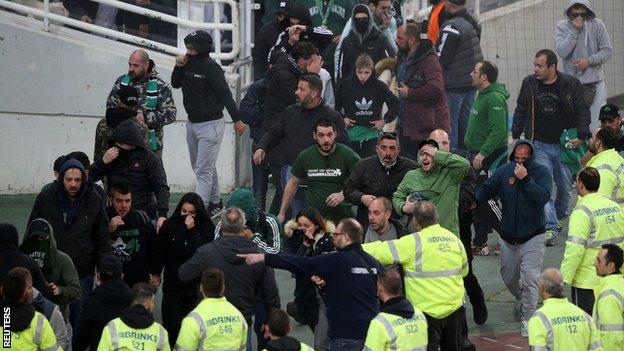 Fans escape tear gas