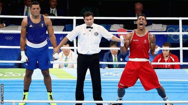 Joe Joyce looks dejected as James Yoka is named Olympic champion