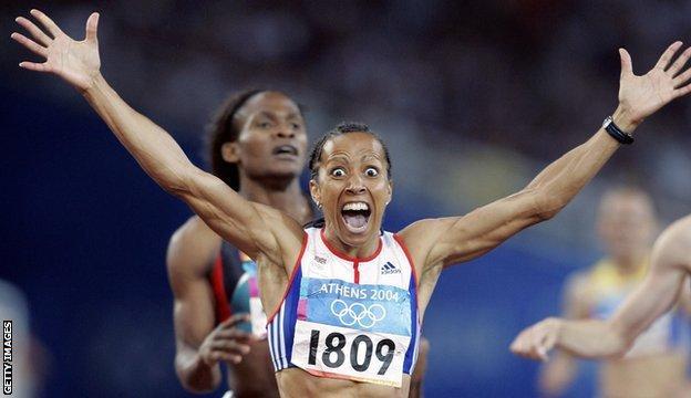 Dame Kelly celebrates winning 800m