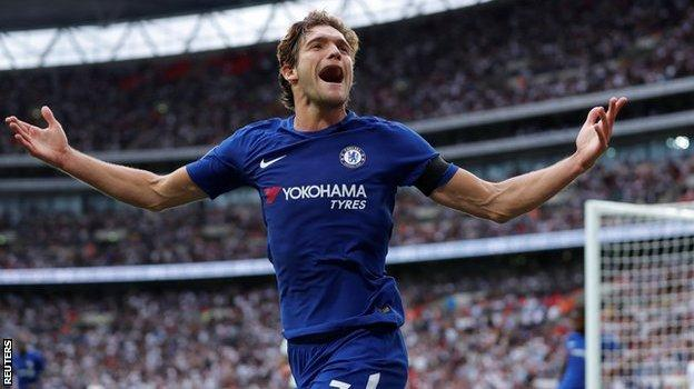Marcos Alonso celebrates scoring his second goal for Chelsea against Tottenham
