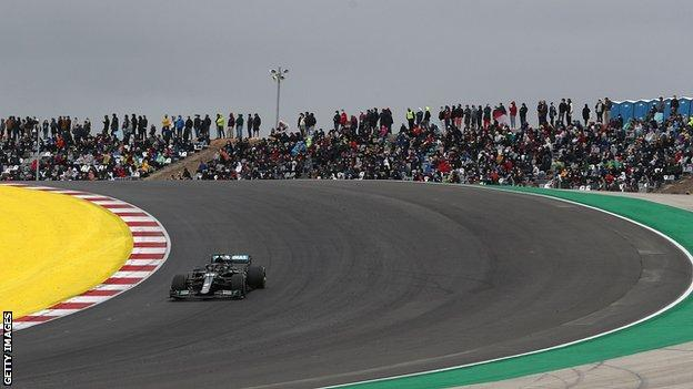 Lewis Hamilton during the Portuguese Grand Prix with large crowds watching in the stands