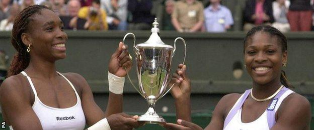 Venus and Serena Williams celebrate their Wimbledon doubles title together in 2000