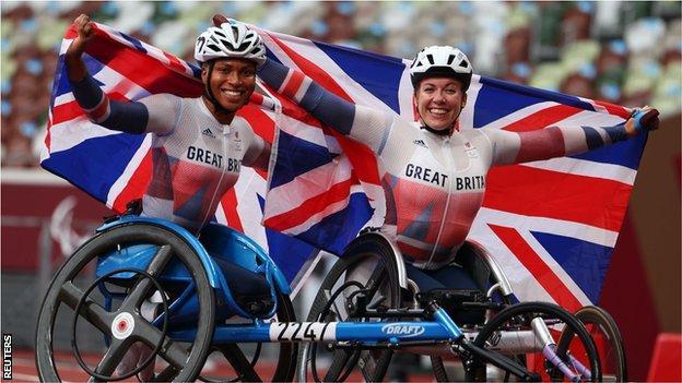 Kare Adenegan and Hannah Cockroft hold aloft British flags
