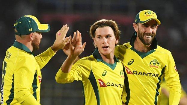 Adam Zampa (centre) took the wicket of India captain Virat Kohli before Glenn Maxwell (right) made 56 for Australia