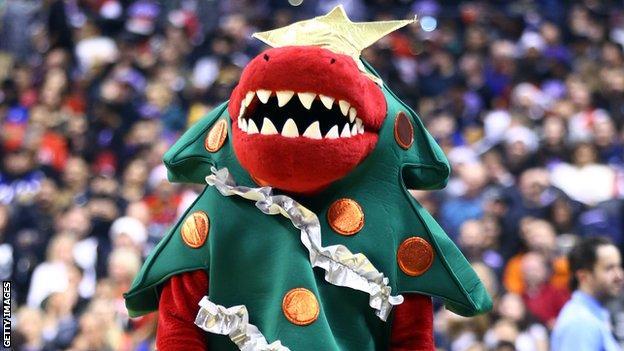 Toronto Raptor mascot dressed as Christmas tree