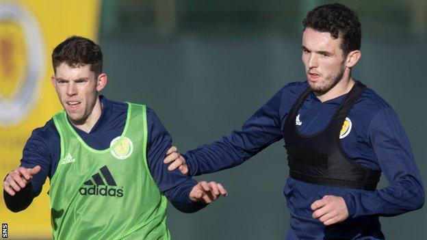 Scotland midfielder Ryan Christie and John McGinn challenge during training