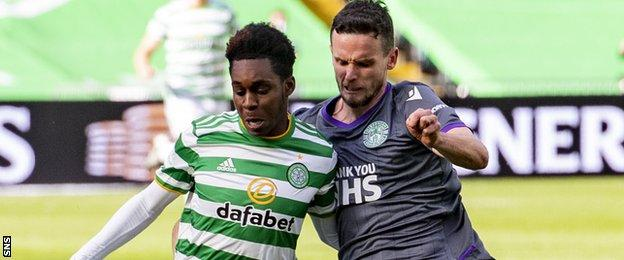 Celtic's Jeremie Frimpong in action against Hibs' Paul McGinn
