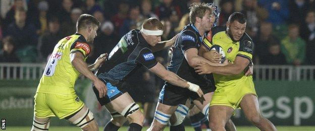 Glasgow forwards Rob Harley and Jonny Gray tackle Leicester's Ellis Genge