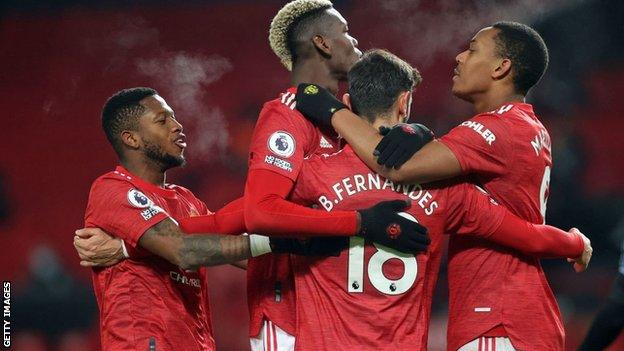 Manchester United players celebrate