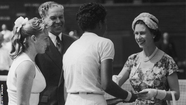 Althea Gibson shakes hands with Queen Elizabeth after winning the Wimbledon ladies' singles in 1957