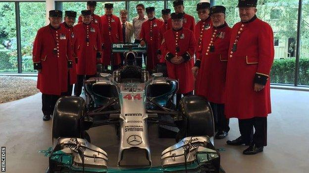 Chelsea pensioners with Mercedes F1 car