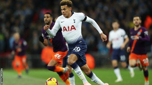 Dele Alli in action for Tottenham against Man City