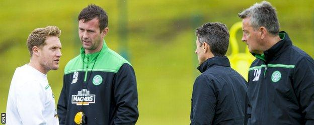 Celtic's Kris Commons, Ronny Deila and John Collins chat during training