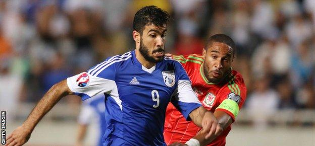 Cyprus' Nestor Mytidis (L) fights for the ball against Wales' Ashley Williams