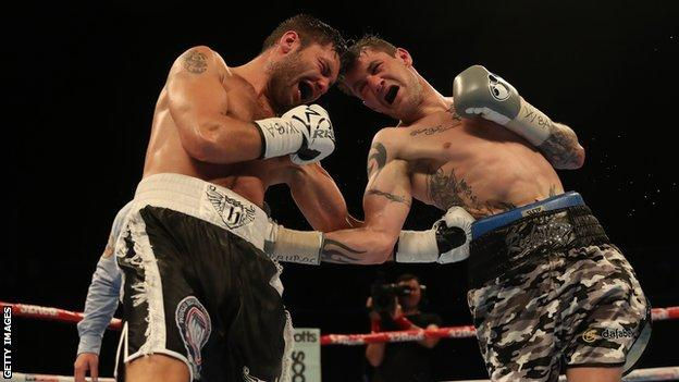 Kiryl Relikh and Ricky Burns exchange ferocious body punches in their 12-round bout