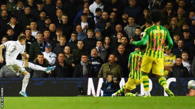 Ezgjan Alioski of Leeds United scores a goal to make it 1-0 against West Brom