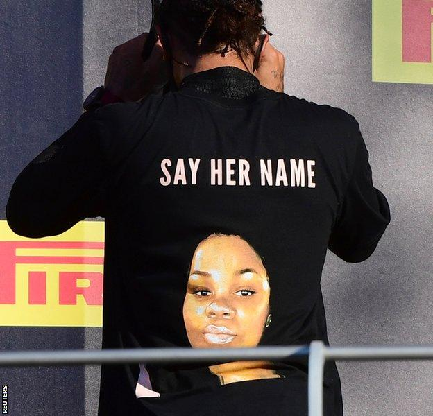 Lewis Hamilton wears a t-shirt in tribute to Breonna Taylor on the podium