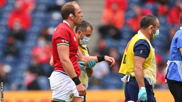 Alun Wyn Jones looks disappointed as he is taken from the field with a dislocated shoulder