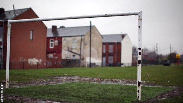 Goalposts on a pitch near homes