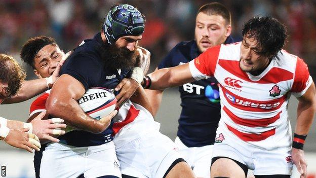Josh Strauss is held up by the Japanese defence
