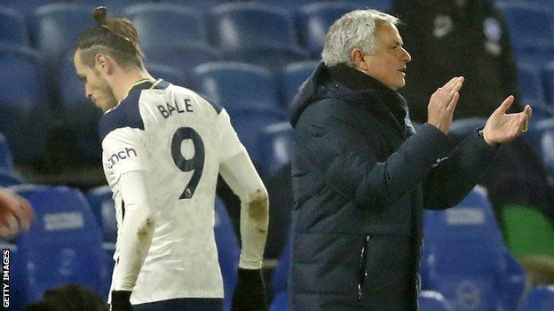 Gareth Bale walks past Jose Mourinho after being substituted during Tottenham's game with Brighton