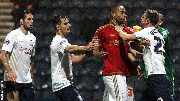Angry Preston North End players surround Nottingham Forest's Dexter Blackstock
