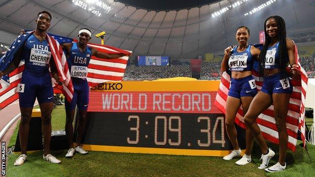 Allyson Felix and her 4x400m mixed relay team-mates celebrating gold and a world record