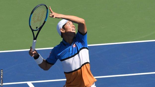 Kei Nishikori prepares to hit an overhead shot