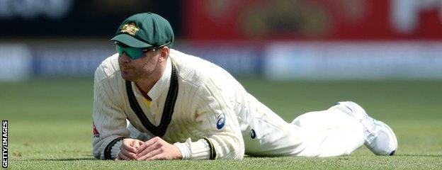 Michael Clarke reacts after dropping Ian Bell