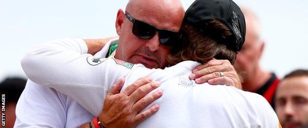 Fernando Alonso hugs Jules Bianchi's father, Philippe