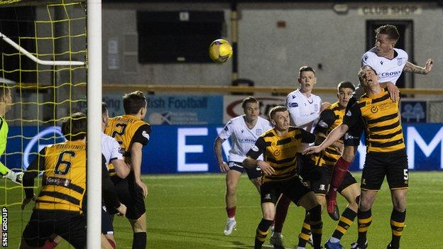 Lee Ashcroft crashes in his first header late in the first half