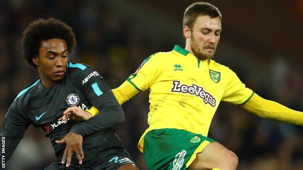Tom Trybull (right) battles for the ball with Chelsea's Willian