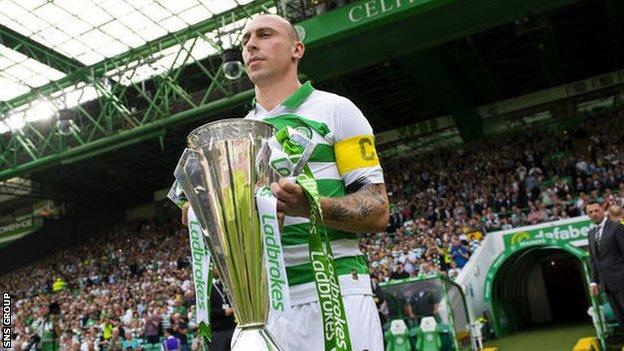 Celtic captain Scott Brown with the Scottish Premiership trophy