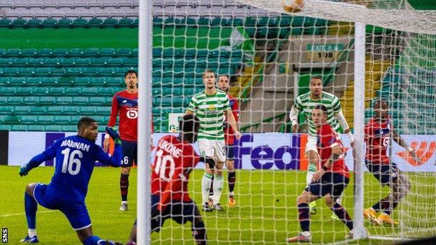 Christopher Jullien (right) opens the scoring for Celtic